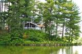 PINE POINT. Enjoy the 180 degree view of Mercer Lake from the screened porch.