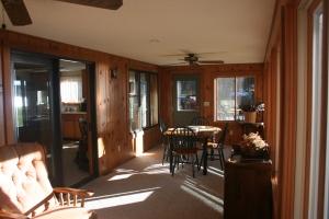 4-season porch overlooks the yard and lake.