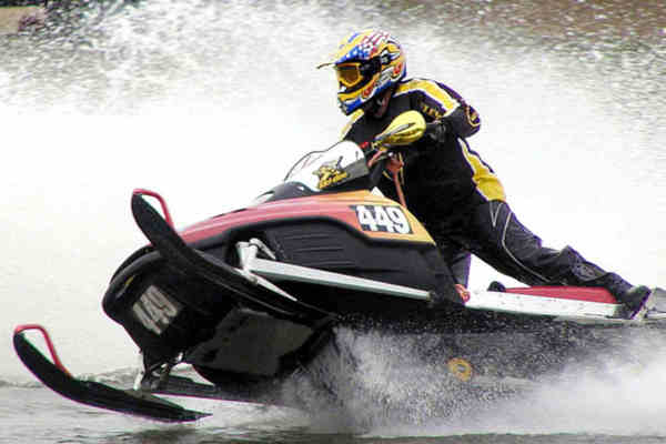 winter Wisconsin Cabins and Vacation Rentals : racing snowmobile on water from rentwisconsincabins-blog.com size 600 x 400 jpeg 20kB